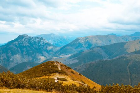 Beautiful autumn mountain landscape, against the blue sky, concept of autumn mountain tourism