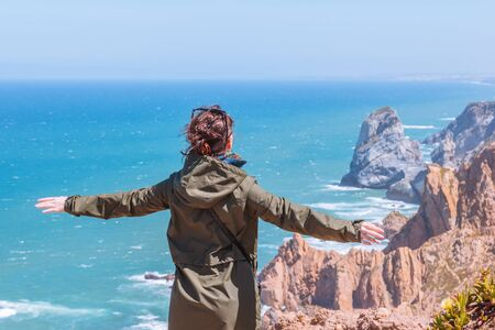 A young girl enjoying a view of the ocean Reklamní fotografie