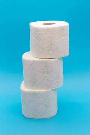 Three rolls of toilet paper, the concept of scarcity and panic buying of toilet paper