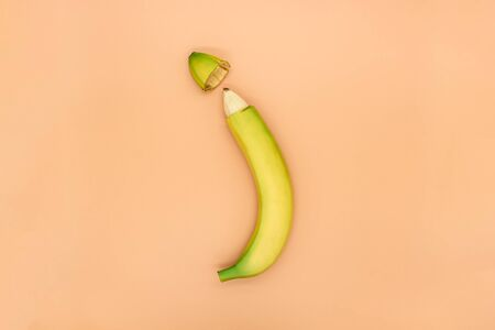 Concept of male circumcision, banana with the tip of the peel cut off