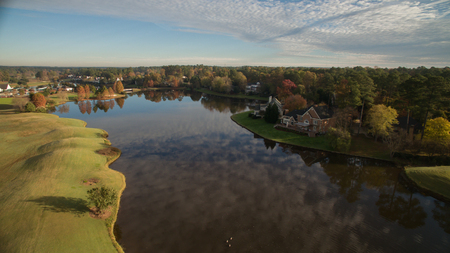 cary: An aerial view of a suburban lake in Cary, NC.