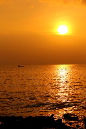 Tropical sunset on the beach,pattaya Thailand photo