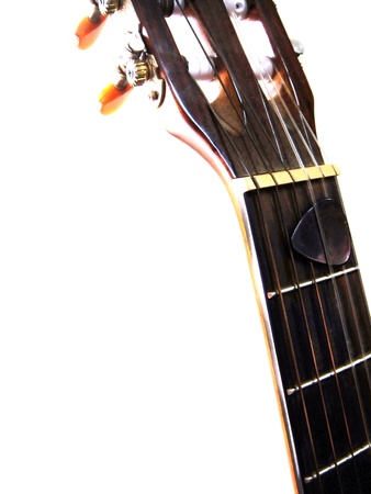 fingerboard: classical guitar,pickisolated  closeup