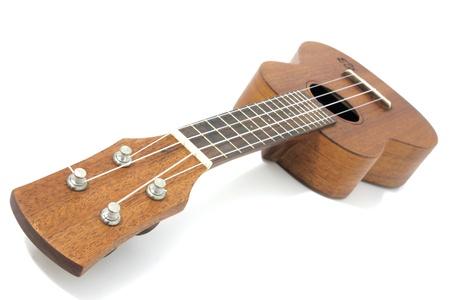 vintage ukulele isolated on white. photo