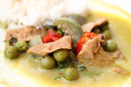 delicious green curry and rice on dish photo