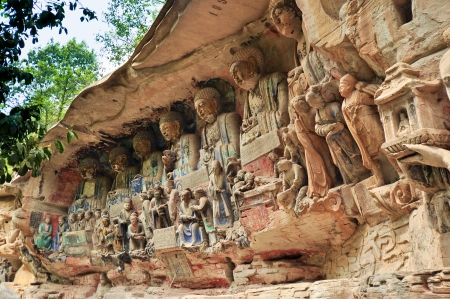 bestowing: Ancient Buddhist Hillside Stone Carving, Parents Bestowing Kindness on Their Children  - Baodingshan, Dazu, China
