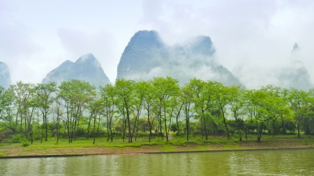 Li River Cruise Scenery on a Foggy and Misty Day - Guilin, China