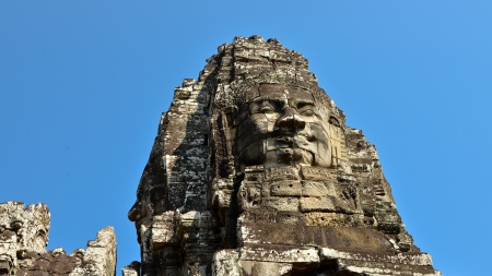 Smiling Stone Face in a Tower of Bayon Temple - Angkor Thom, Cambodia Stock Photo