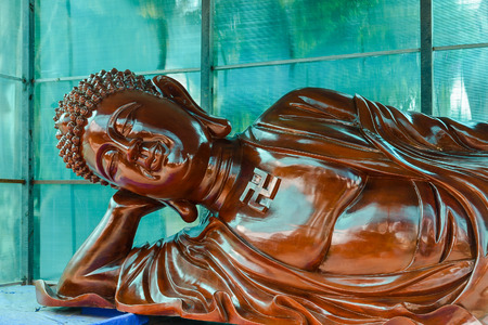 eastern philosophy: Giant Wood Carving of Reclining Buddha - Vietnam