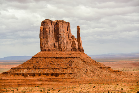 geologic: Mitten Butte Under Cloudy Skies - Monument Valley, Navajo Tribal Park, Arizona Stock Photo
