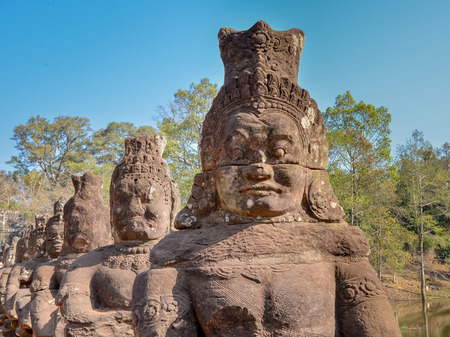 anthropological: Asuras (demon gods) by South Gate Entrance to Angkor Thom, Cambodia Stock Photo
