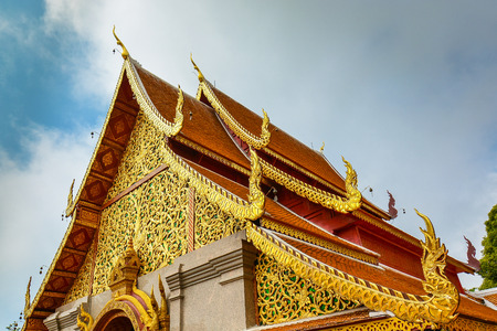 buddhist temple roof: Details, Roof and Eaves of Thai Buddhist Temple - Chiang Mai, Thailand Stock Photo