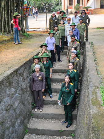 Quang Tri, Vietnam - Apr-15-2011: North Vietnam Army veterans of the Vietnam-American war gather by the steps of Entrance 13 to Vin Moc tunnels to commemorate their wartime sacrifices and struggles.