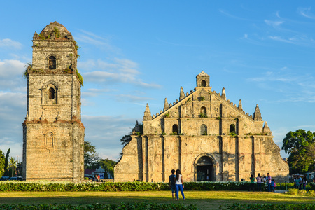 Paoay, Philippines - Dec. 15, 2012: Paoay Church and Belfry. This church was declared a National Cultural Treasure by the Philippine government in 1973 and a UNESCO World Heritage Site in 1993.