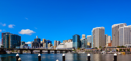 Sydney, Australia - Jan. 27, 2017: Panorama of modern high rises by Darling Harbour, Sydney, NSW, Australia on Jan 27, 2017.