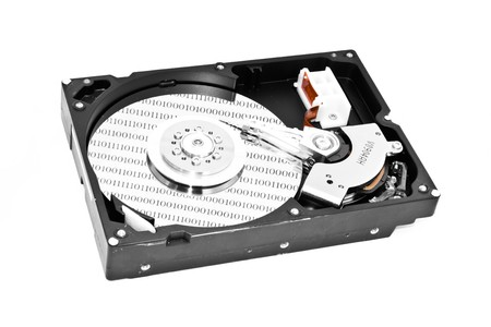 Close-up inside view of hard disk isolated on white background Stock Photo - 8071590