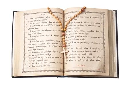 vangelo aperto: Ha aperto la Sacra Bibbia con croce