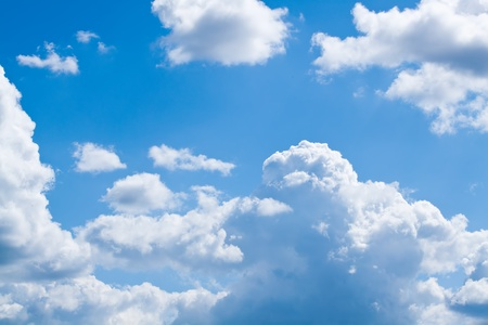 cloud background: white fluffy clouds in the blue sky