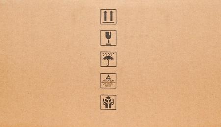 Fine image close-up of black fragile symbol on cardboard