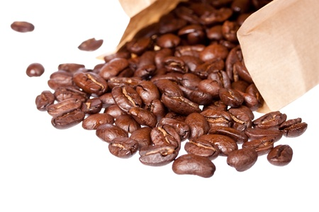 Coffee beans in sack isolated on white background photo
