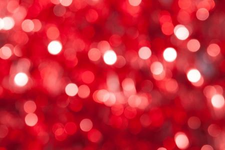 Sans mise au point abstraite rouge de fond de Noël