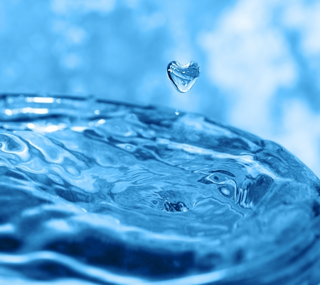 Water splash with drop in the form of heart Stock Photo