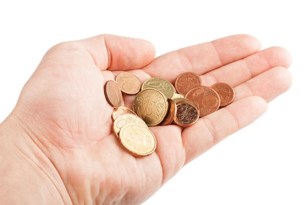 Hand with coins isolated on white background Stock Photo - 17475271