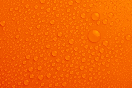 Water drops on orange background Stock Photo - 17890189