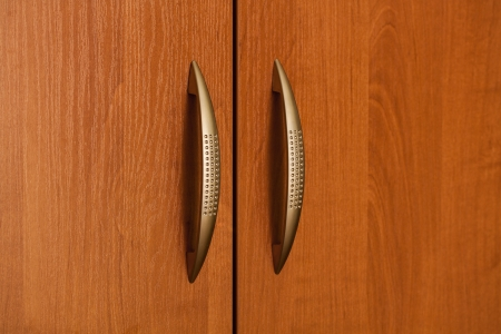 Part Of Wooden Door With Metal Handle photo