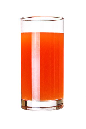 Glass of pink grapefruit juice isolated on white photo