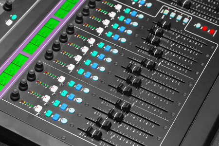 Adjusting Audio Mixing Console photo