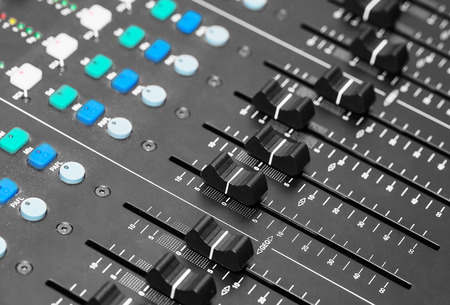 Adjusting Audio Mixing Console photo