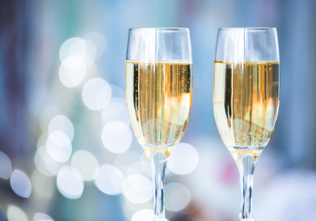 champagne flutes: Two champagne glass on christmas bokeh background
