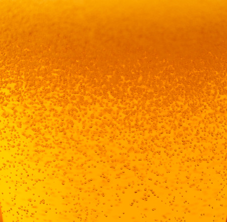 Beer with foam and bubbles photo