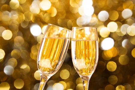 Two champagne glass on christmas bokeh background Two champagne glass on christmas bokeh background photo