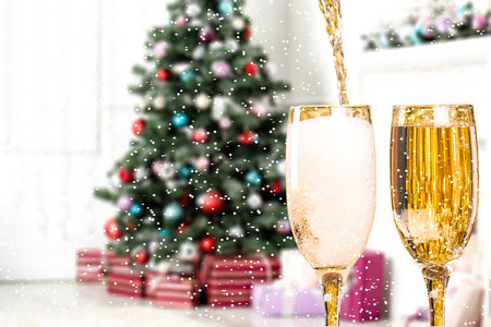 Two Champagne Glasses On Defocused Background Living Room With Christmas Tree photo