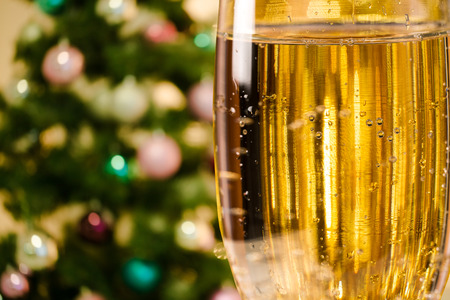Champagne Glass On Defocused Background Living Room With Christmas Tree photo