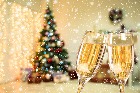hearthside: Two Champagne Glass With Stars And Snow On Defocused Background Living Room With Christmas Tree