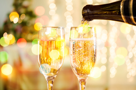 hearthside: Two Champagne Glasses On Defocused Background Living Room With Christmas Tree