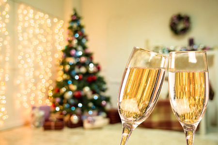 hearthside: Two Champagne Glass On Defocused Background Living Room With Christmas Tree Stock Photo