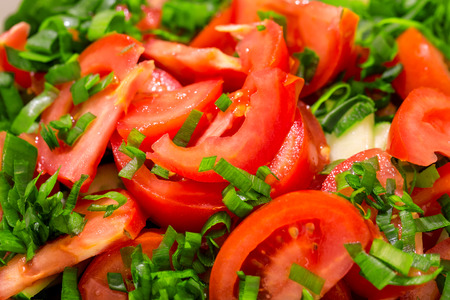 tomato slices: Tomato slices background with greens