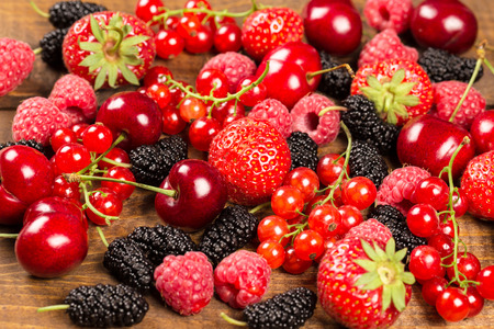 Collection of cherries, strawberries, mulberries, red currants, raspberries for background Stock Photo