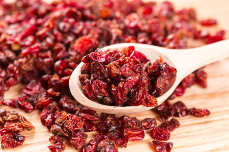 barberry: Dry red barberry spices in the wooden spoons