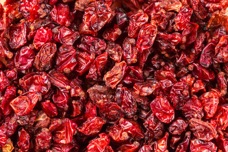 barberries: Dried red Tibetan spicy barberries placer background Stock Photo