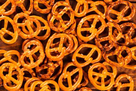 pretzel stick: Typical bavarian pretzel on old wooden table Stock Photo