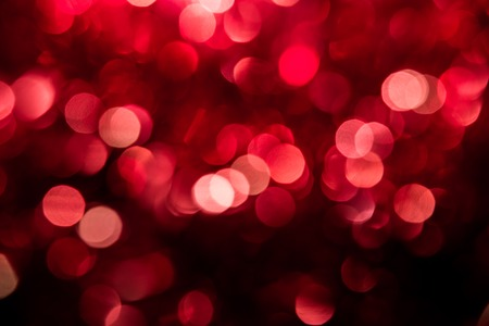 unfocused: Abstract red and pink circular bokeh background of Christmas light Stock Photo