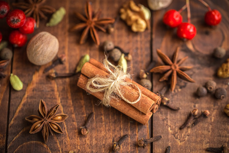 christmas spices: Collection of spices for mulled wine and pastry on the wooden table Stock Photo