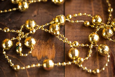 gold ornaments: Christmas Garland on the wood bachground