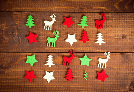 xmas background: Christmas decoration on the wood background. Collection of xmas miniatures.