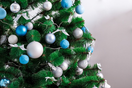 mantelpiece: Decorated Christmas tree. Beautiful Christmas living room with Christmas tree